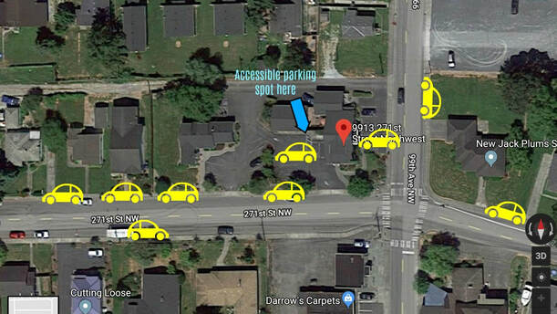 Photo illustration with yellow cars marking available parking for the shop, plus accessible parking